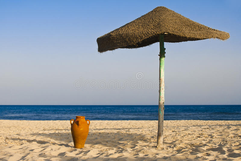 Download Amphora and umbrella stock image. Image of round, natural - 26299015