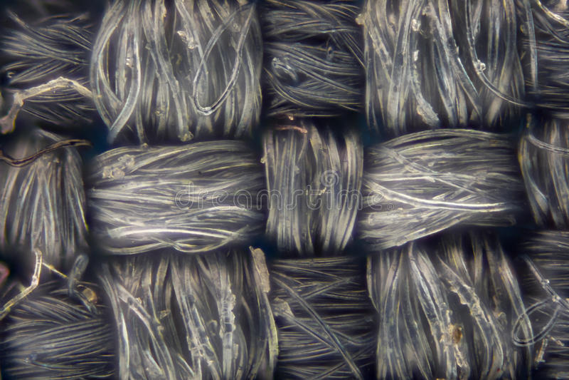 Ampliación extrema - el gris sucio hizo punto textura de la tela imagen de archivo libre de regalías