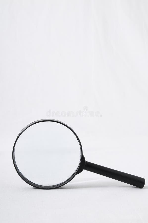 Amplie a lupa de vidro imagens de stock royalty free