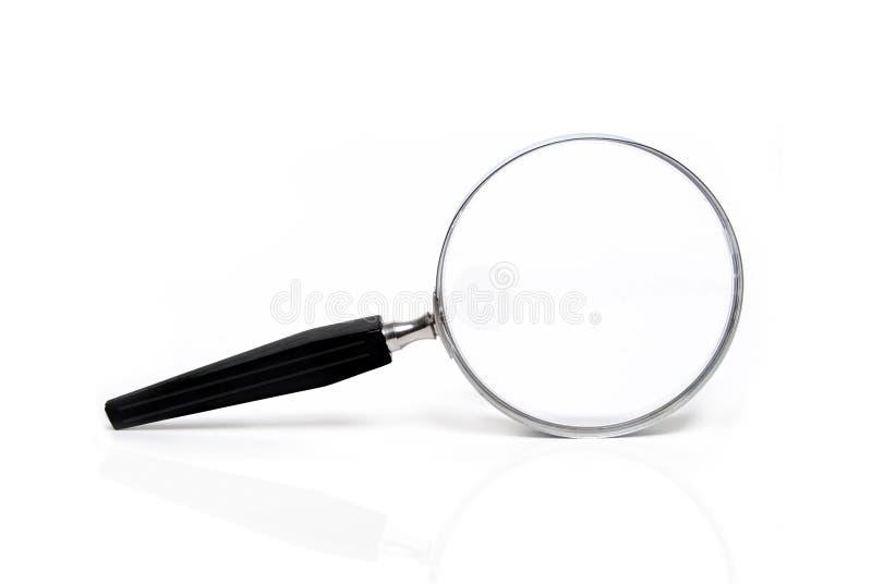 Amplie o vidro foto de stock