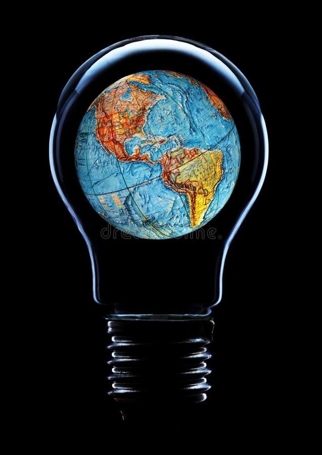 Ampoule avec la terre de planète image stock