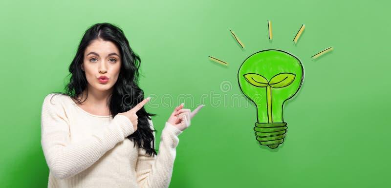 Ampoule d'Eco avec la jeune femme image stock