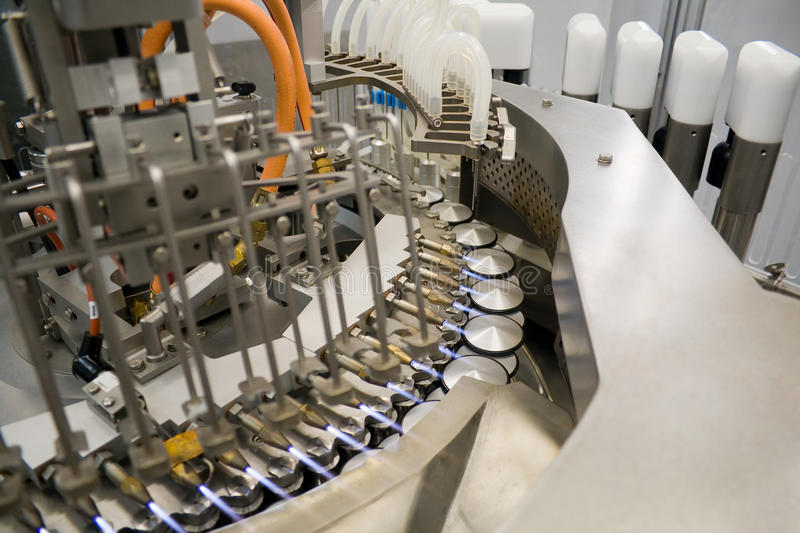 Download Ampoule Filling And Sealing Machine Stock Photos - Image: 18467923