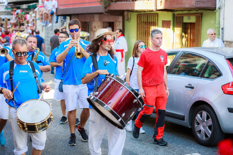 AMPUERO, SPAIN - SEPTEMBER 10: Unidentified group of musicians with a saxophone before the Bull Run on the street during festival. In Ampuero, celebrated on royalty free stock image