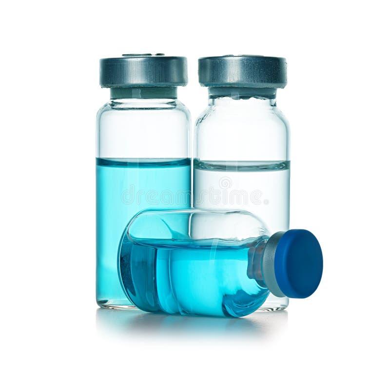 Ampules, flessen, flesjes op wit worden geïsoleerd dat royalty-vrije stock foto's