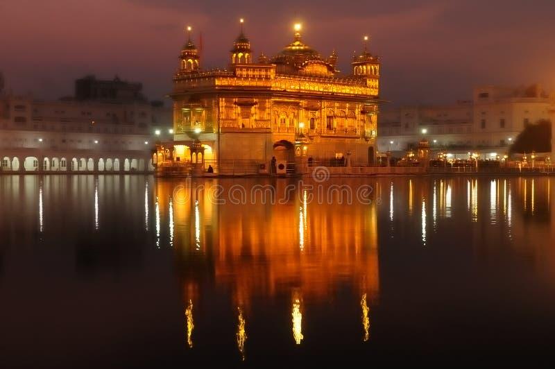 Amritsar, Golden Temple, India. INDIA, AMRITSAR - NOVEMBER 11: Pilgrims praying at the Golden temple (Sri Harimandir Sahib), Amritsar in November 11, 2009 stock images