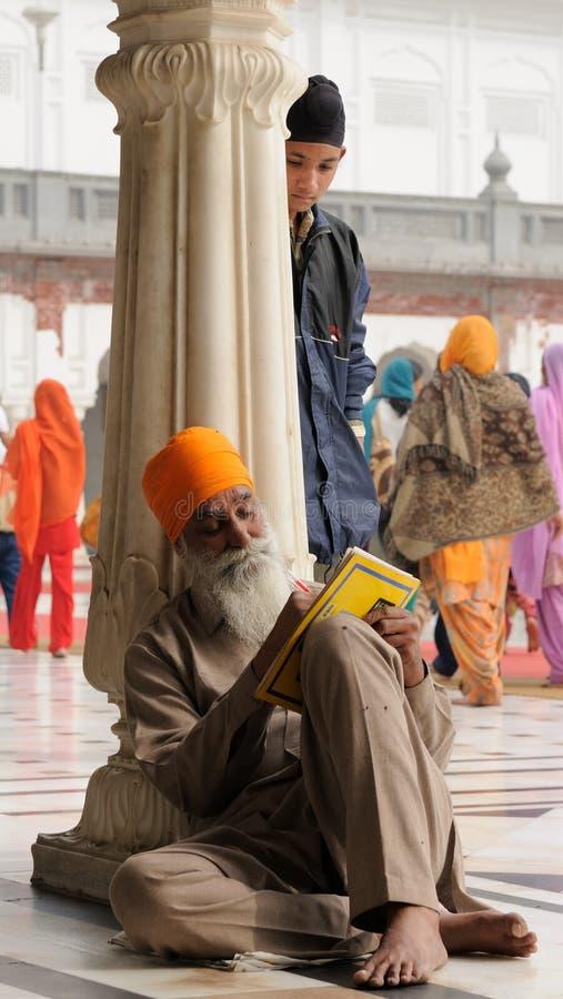 Amritsar. INDIA, AMRITSAR - NOVEMBER 29: Pilgrim in the Golden temple (Sri Harimandir Sahib), Amritsar in November 29, 2009 stock photography