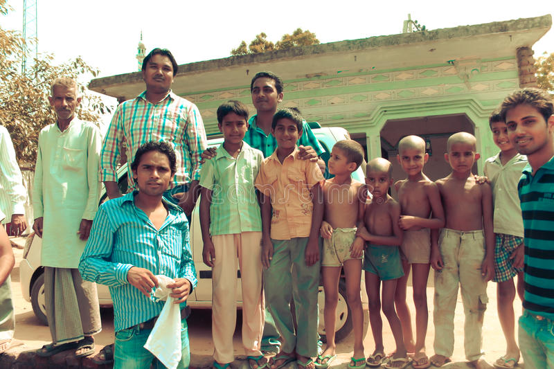 Amroha, Utter Pradesh, INDIA - 2011: Unidentified poor people living in slum. Smiling children royalty free stock photos