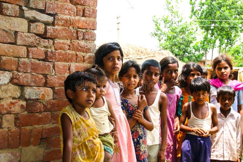 Amroha, Utter Pradesh, INDIA - 2011: Unidentified poor people living in slum. Smiling children royalty free stock images