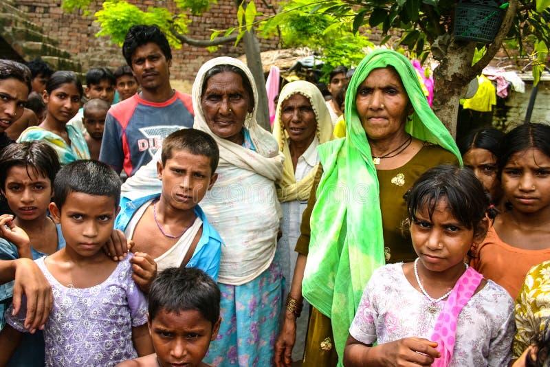 Amroha, Utter Pradesh, INDIA - 2011: Unidentified poor people living in slum. Smiling children royalty free stock image