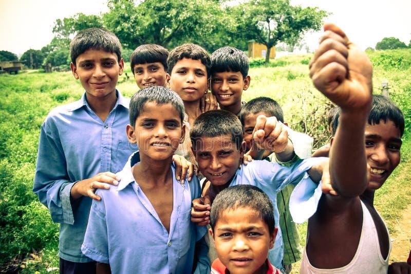 Amroha, Utter Pradesh, INDIA - 2011: Unidentified poor people living in slum. Smiling children royalty free stock photography