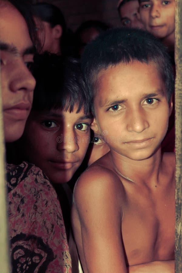 Amroha, Utter Pradesh, INDIA - 2011: Unidentified poor people living in slum. Smiling children royalty free stock photo