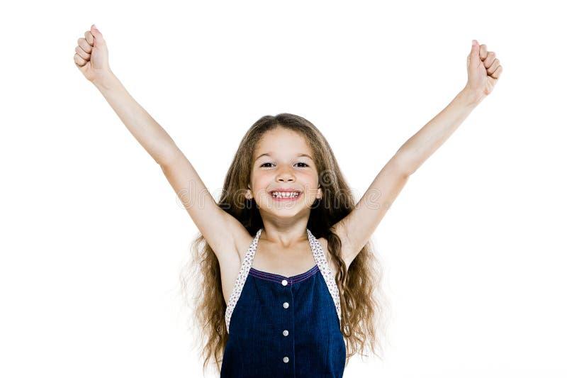 Amrs heureux réussis de petite fille augmentés photographie stock libre de droits