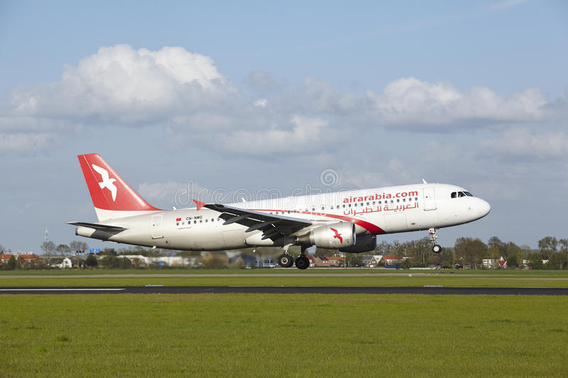 Amsterdam Airport Schiphol - A320 of Air Arabia Maroc lands. An Airbus A320-214 of Air Arabia Maroc lands at Amsterdam Airport Schiphol (The Netherlands, AMS) on stock images