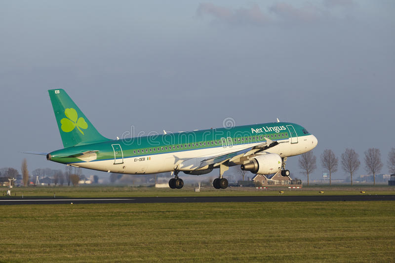 Amsterdam Airport Schiphol - Air Lingus Airbus A320 lands. The Air Lingus Airbus A320-214 with identification EI-DEB lands at Amsterdam Airport Schiphol The stock photography