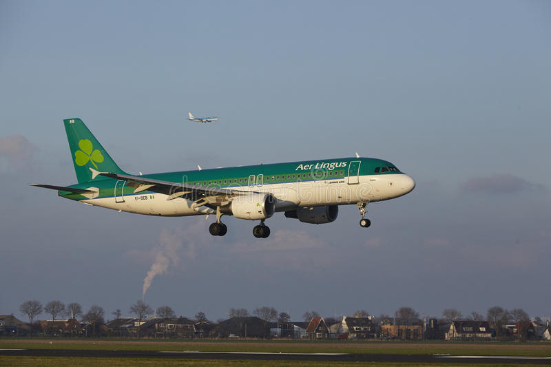 Amsterdam Airport Schiphol - Air Lingus Airbus A320 lands. The Air Lingus Airbus A320-214 with identification EI-DEB lands at Amsterdam Airport Schiphol The royalty free stock photos