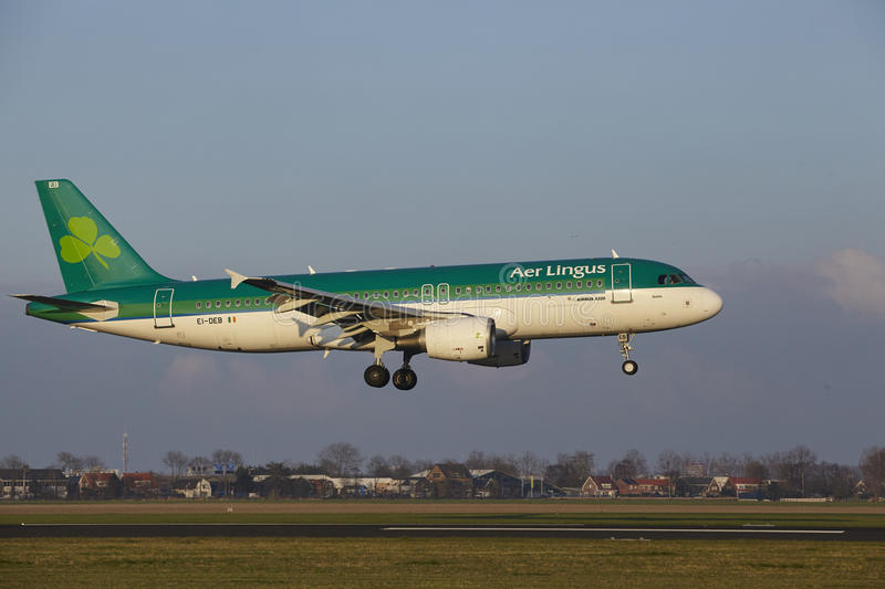 Amsterdam Airport Schiphol - Air Lingus Airbus A320 lands. The Air Lingus Airbus A320-214 with identification EI-DEB lands at Amsterdam Airport Schiphol The stock image
