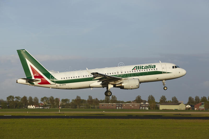 Amsterdam Airport Schiphol - Airbus A320 of Alitalia lands stock photos
