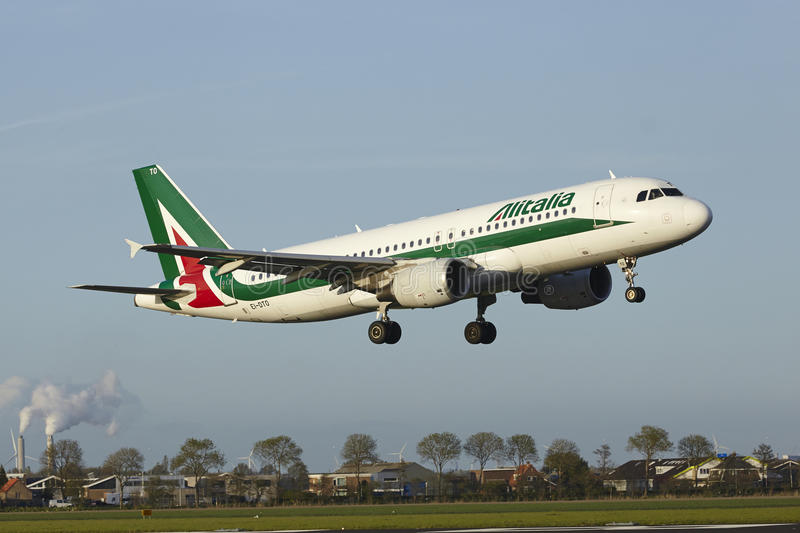 Amsterdam Airport Schiphol - Airbus A320 of Alitalia lands stock photo
