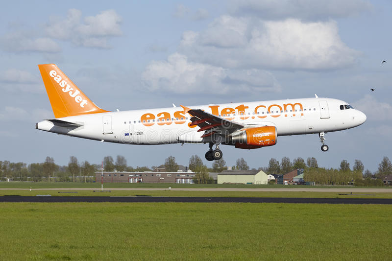 Amsterdam Airport Schiphol - Airbus A320 of EasyJet lands. An Airbus A320-214 of EasyJet lands at Amsterdam Airport Schiphol (The Netherlands, AMS) on May 7 stock photo