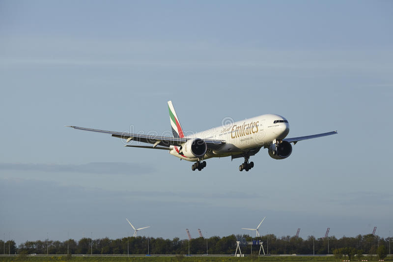 Amsterdam Airport Schiphol - Boeing 777 of Emirates lands royalty free stock photo