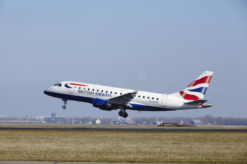 Amsterdam Airport Schiphol - British Airways Embraer 170 takes off. The British Airways Embraer ERJ-170STD with identification G-LCYH takes off at Amsterdam royalty free stock photos