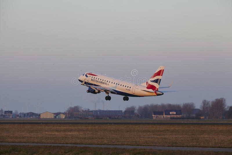 Amsterdam Airport Schiphol - British Airways Embraer 170 takes off. The British Airways Embraer ERJ-170STD with identification G-LCYH takes off at Amsterdam stock photos
