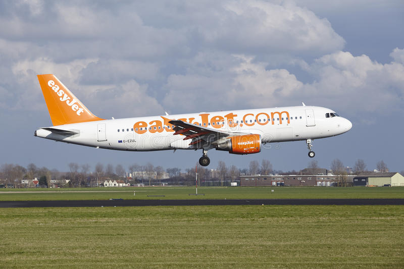 Amsterdam Airport Schiphol - Easyjet Airbus A320 lands. The Easyjet Airbus A320-214 with identification G-EZUL lands at Amsterdam Airport Schiphol The stock image