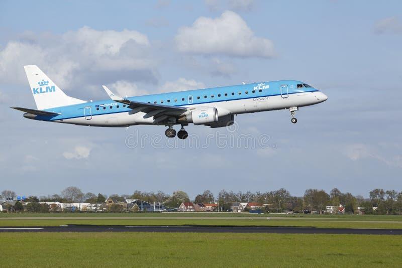 Amsterdam Airport Schiphol - Embraer ERJ-190 of KLM Cityhopper lands royalty free stock image