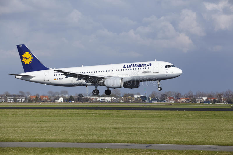 Amsterdam Airport Schiphol - Lufthansa Airbus A320 lands. The Lufthansa Airbus A320-214 with identification D-AIZD lands at Amsterdam Airport Schiphol The royalty free stock image