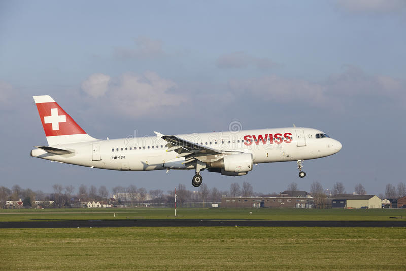 Amsterdam Airport Schiphol - Swiss Airline Airbus A320 lands. The SWISS Airbus A320-214 with identification HB-IJR lands at Amsterdam Airport Schiphol The royalty free stock photo