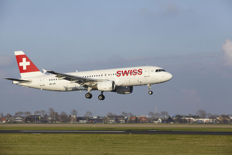 Amsterdam Airport Schiphol - Swiss Airline Airbus A320 lands. The SWISS Airbus A320-214 with identification HB-IJR lands at Amsterdam Airport Schiphol The royalty free stock photos