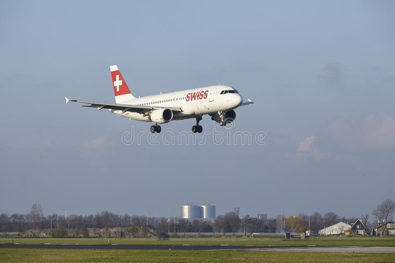 Amsterdam Airport Schiphol - Swiss Airline Airbus A320 lands. The SWISS Airbus A320-214 with identification HB-IJR lands at Amsterdam Airport Schiphol The stock photography