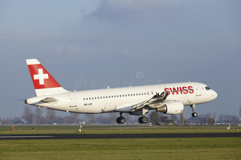 Amsterdam Airport Schiphol - Swiss Airline Airbus A320 lands. The SWISS Airbus A320-214 with identification HB-IJR lands at Amsterdam Airport Schiphol The royalty free stock photography