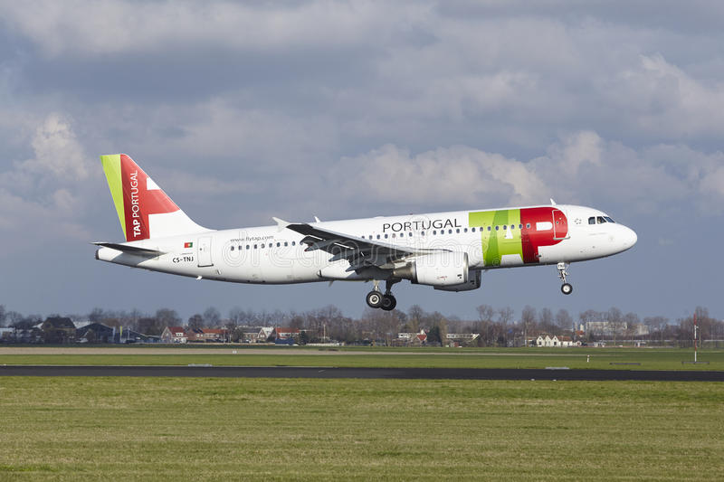 Amsterdam Airport Schiphol - TAP Portugal Airbus A320 lands. The TAP Portugal Airbus A320-214 with identification CS-TNJ lands at Amsterdam Airport Schiphol The royalty free stock photography