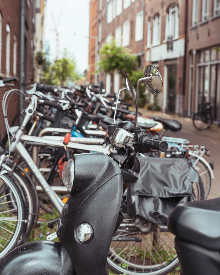 Amsterdam alley with parked bicycles in a beautiful neighborhood. In an alley stock images
