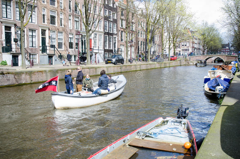 AMSTERDAM - APRIL 2016 - boat with tourists on the canal. stock images