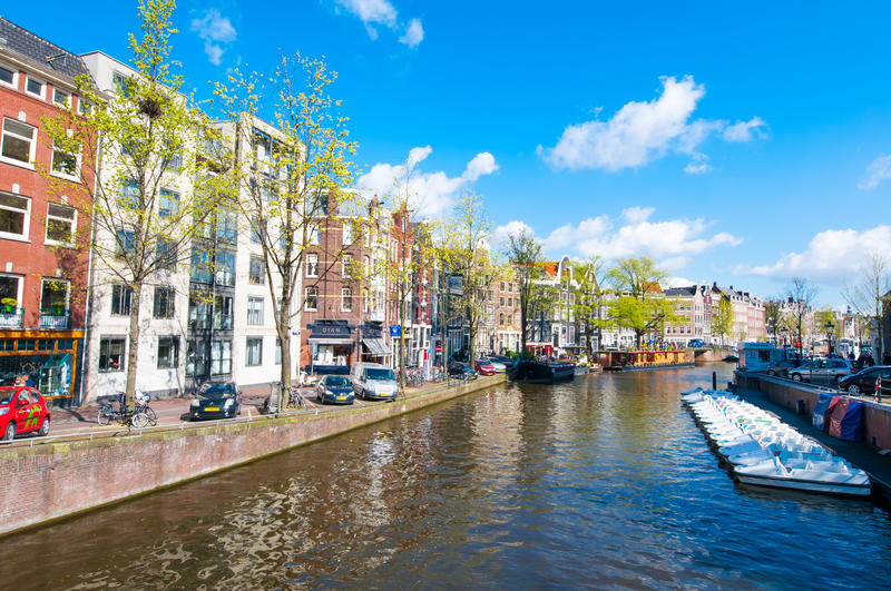AMSTERDAM-APRIL 30: The Prinsengracht canal (Prince's Canal) with row of boats on April 30,2015. Prinsengracht is the third of the three main canals royalty free stock photo