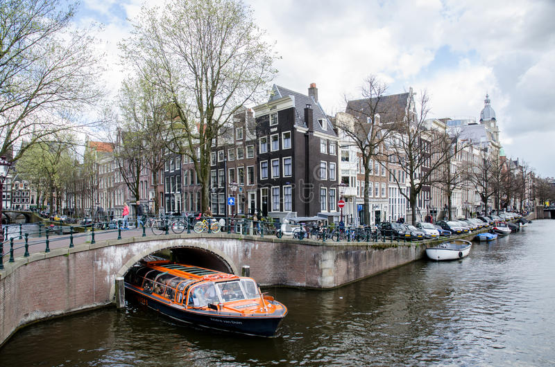 AMSTERDAM - APRIL 2016 - Sightseeing boat tour on Amsterdam canal. stock images
