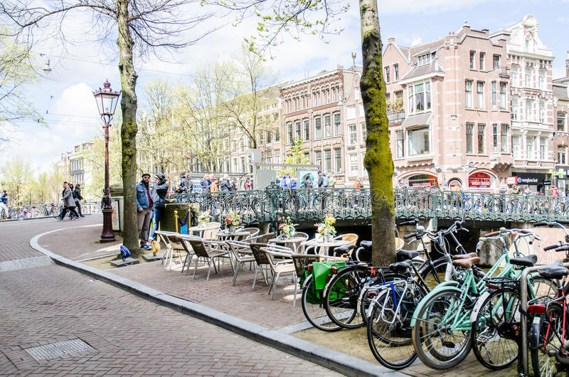 AMSTERDAM - APRIL 2016 - street scene with bikes and local people. royalty free stock photography