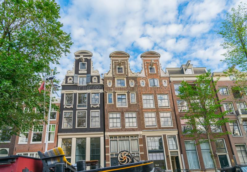 Neck gables over four story residences. Amsterdam architectural gables are renown for their different styles, here example of neck gables over four store stock photos