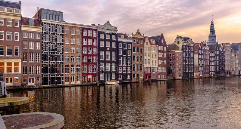 Amsterdam Architecture and buildings, chanels and great Sunset. Great warm sunset in Amsterdam with beautiful and warm colours on the buildings royalty free stock images