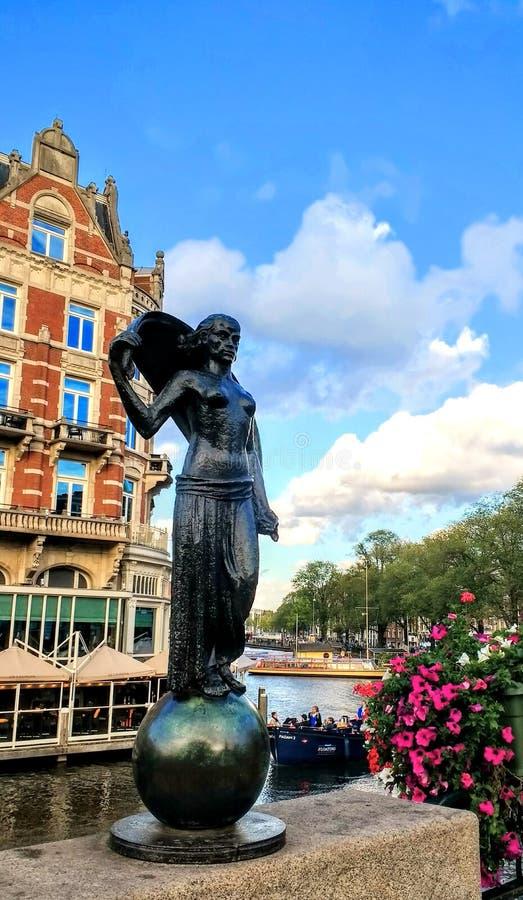 Amsterdam Architektur statue. Amsterdam Architektur city travel view canal sky stock images