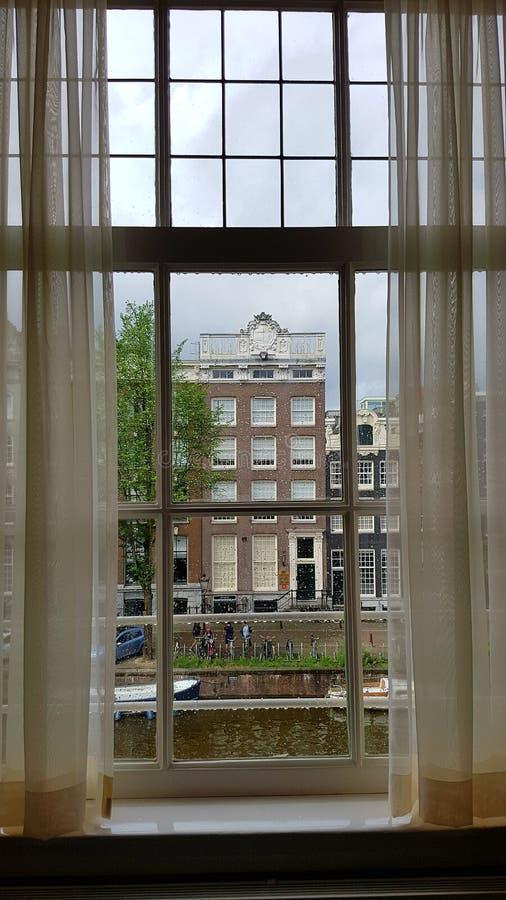 Amsterdam attraverso vetro fotografia stock