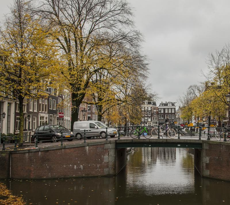 Amsterdam in autumn, canals and streets. This image shows a view of a canal in Amsterdam. the Netherlands. It was taken in autumn 2017 stock photo