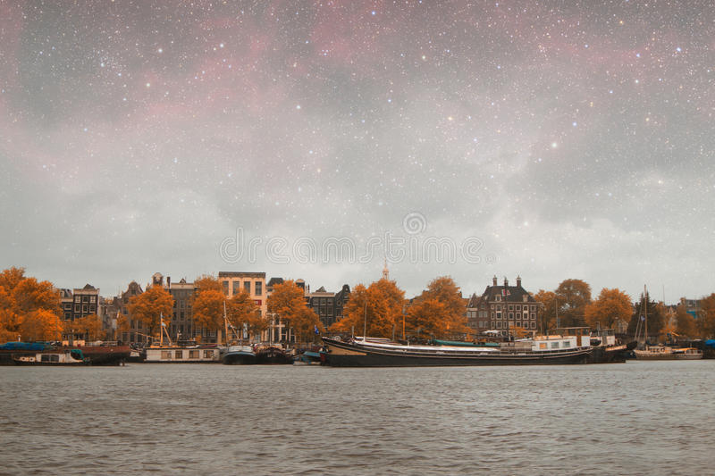 Amsterdam autumn night. Elements of this image furnished by NASA summer stock images
