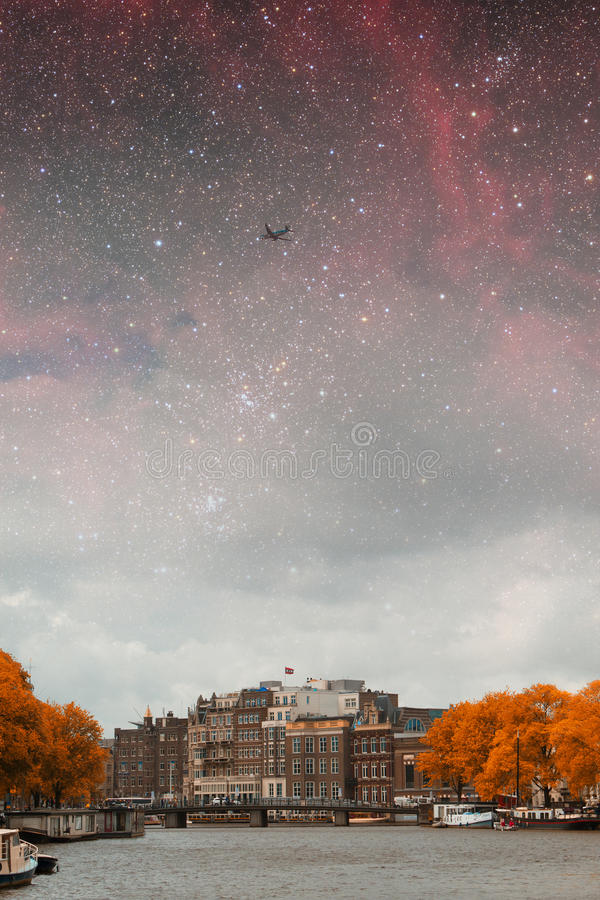 Amsterdam autumn night. Elements of this image furnished by NASA summer royalty free stock photography