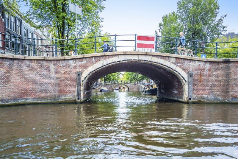 Amsterdam in barca fotografie stock libere da diritti