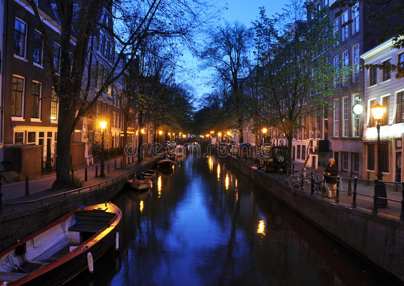Amsterdam Canal. Canals and light of Amsterdam at night stock photo