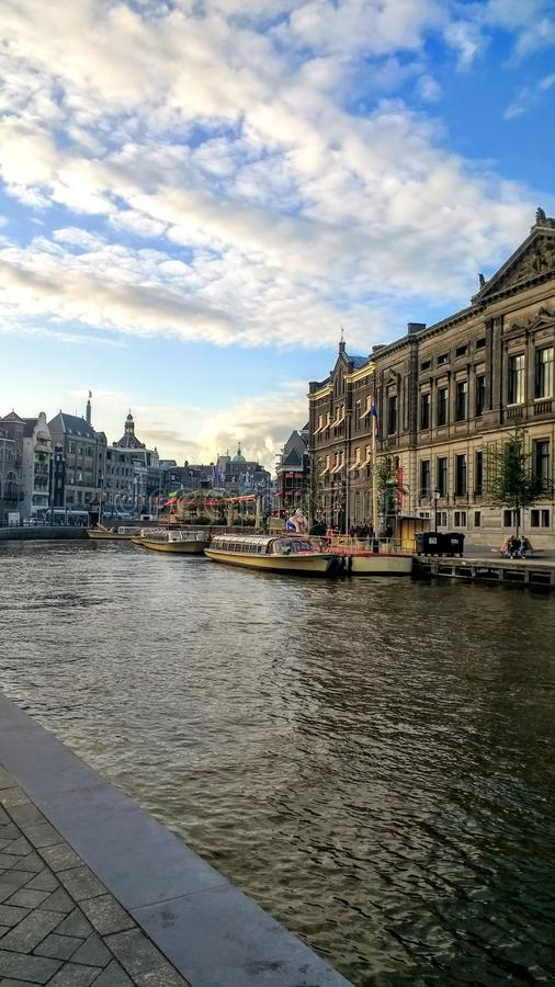 Amsterdam canal architecture sunset. Amsterdam Architektur city travel view canal sky royalty free stock image
